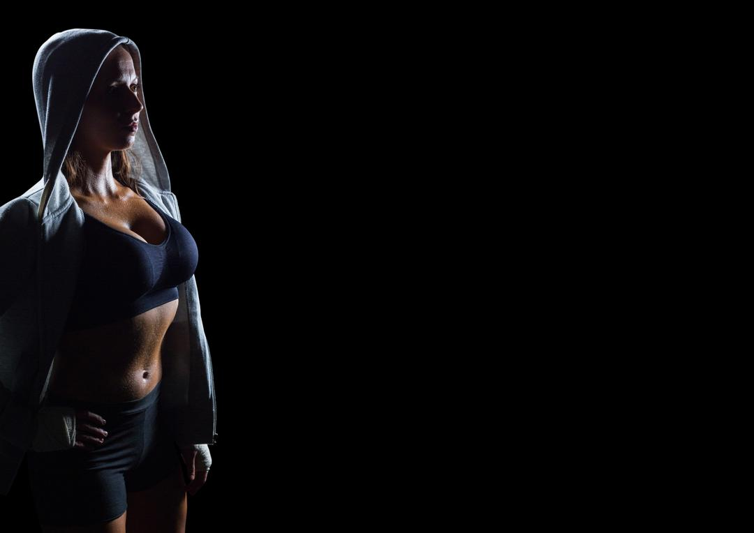 Digital composite of Female athlete in hoodie looking up against black background Free Stock Images from PikWizard