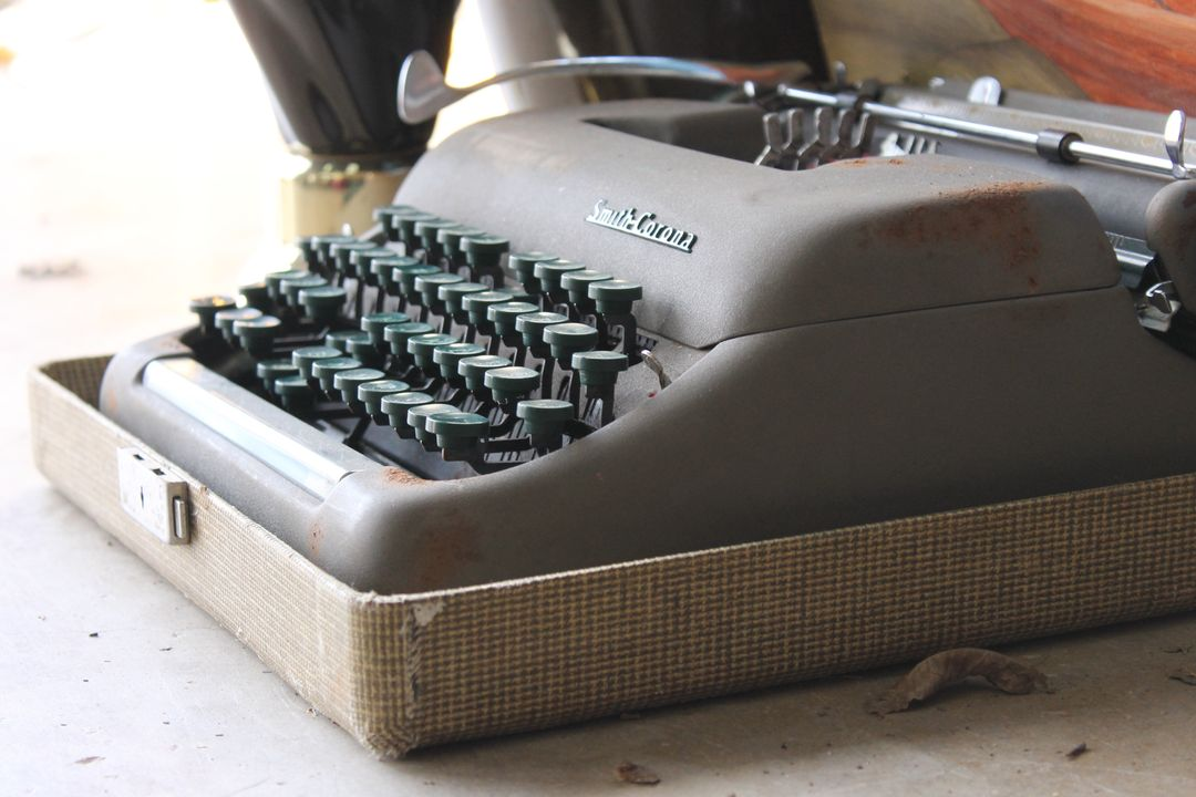 Side image of an old typewriter that is covered in dust