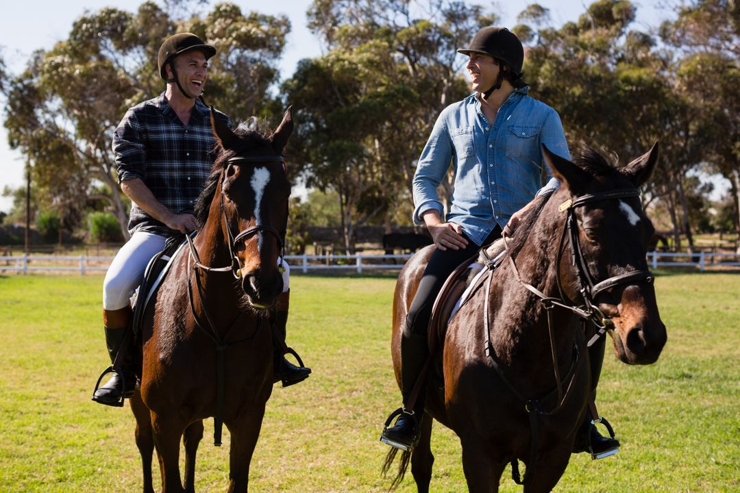 Two male friends riding horse in the ranch on a sunny day Free Stock Images from PikWizard