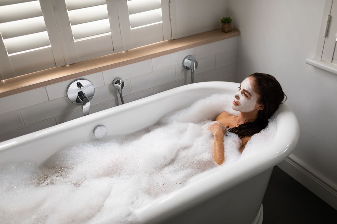 High angle view of beautiful woman relaxing in bathtub at bathroom Free Stock Images from PikWizard