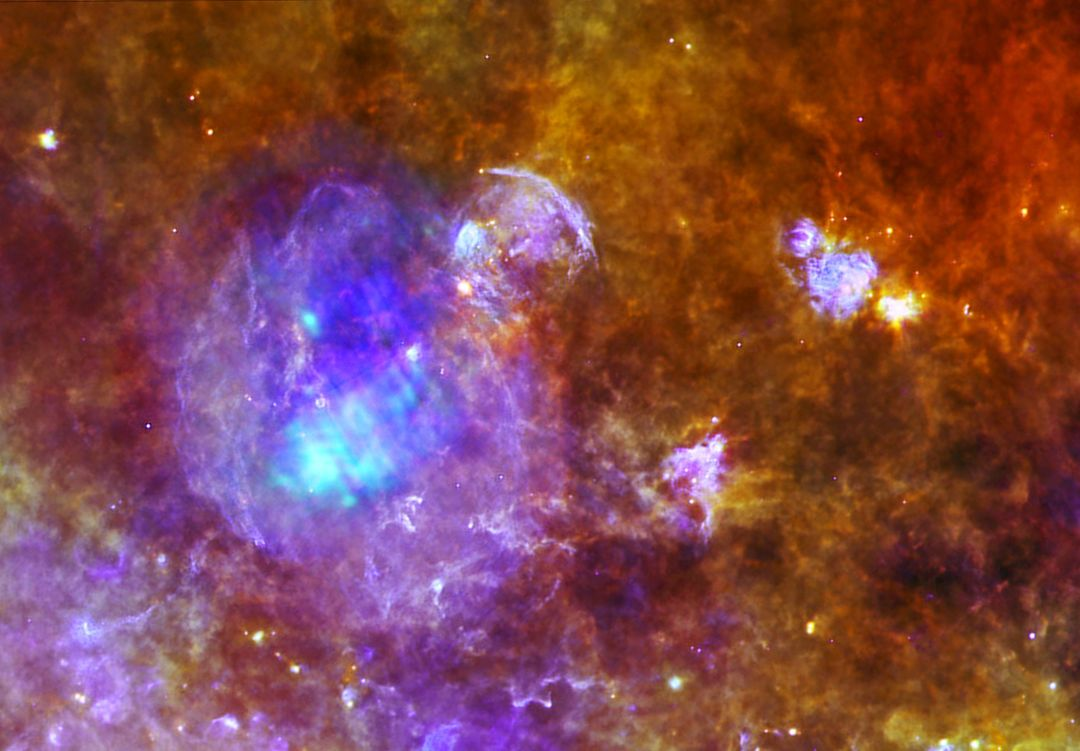 W44 is located around 10,000 light-years away, within a forest of dense star-forming clouds in the constellation of Aquila, the Eagle. This image combines data from ESA Herschel and XXM-Newton space observatories.