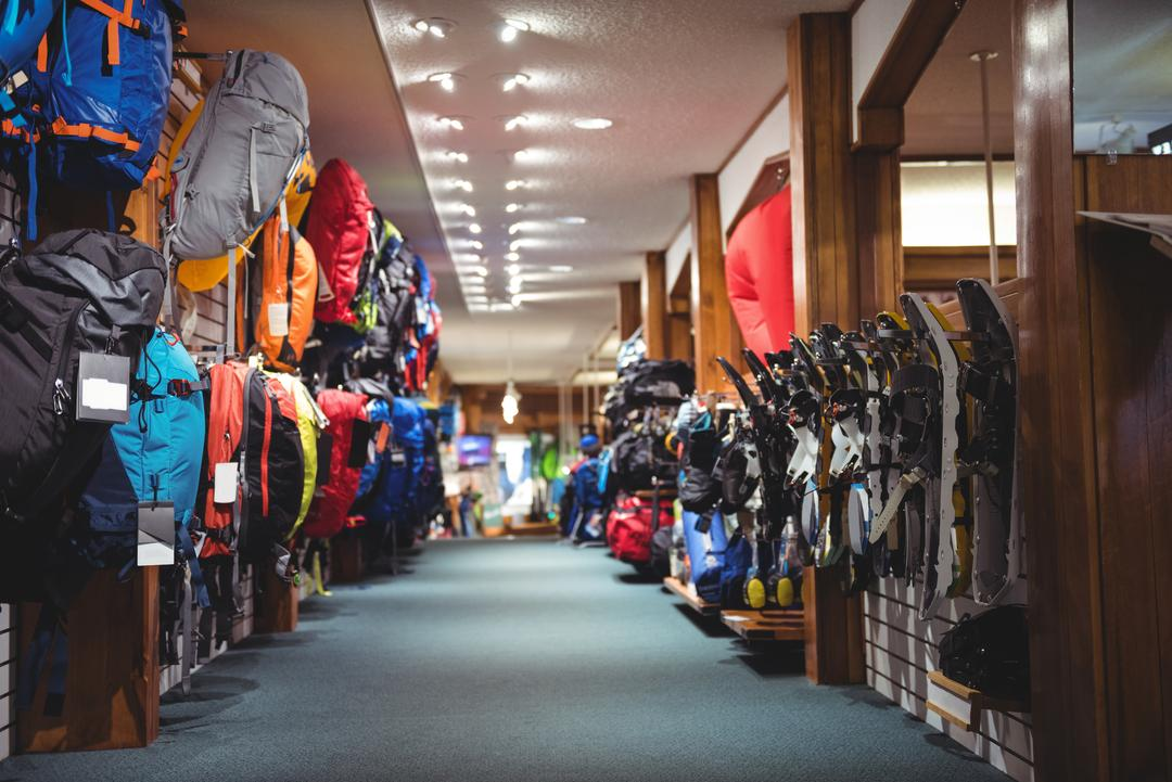 Interior of a sportswear store with backpacks and equipment