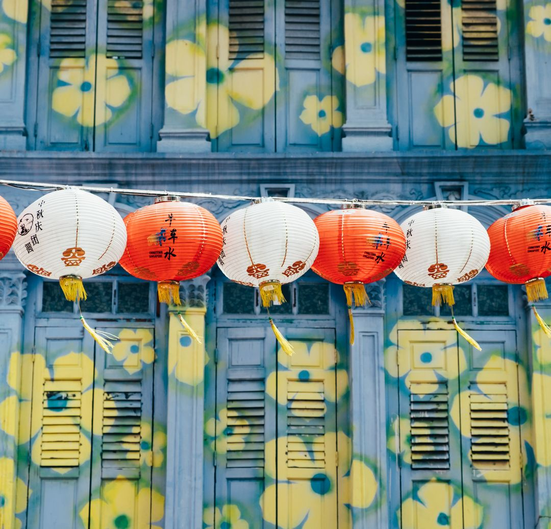 Multi colored lanterns hanging in row