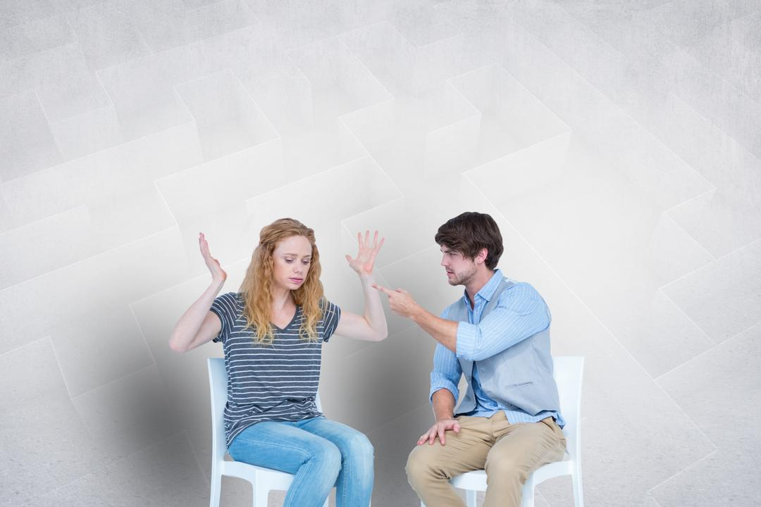 Digital composite of Couple arguing while sitting on chairs