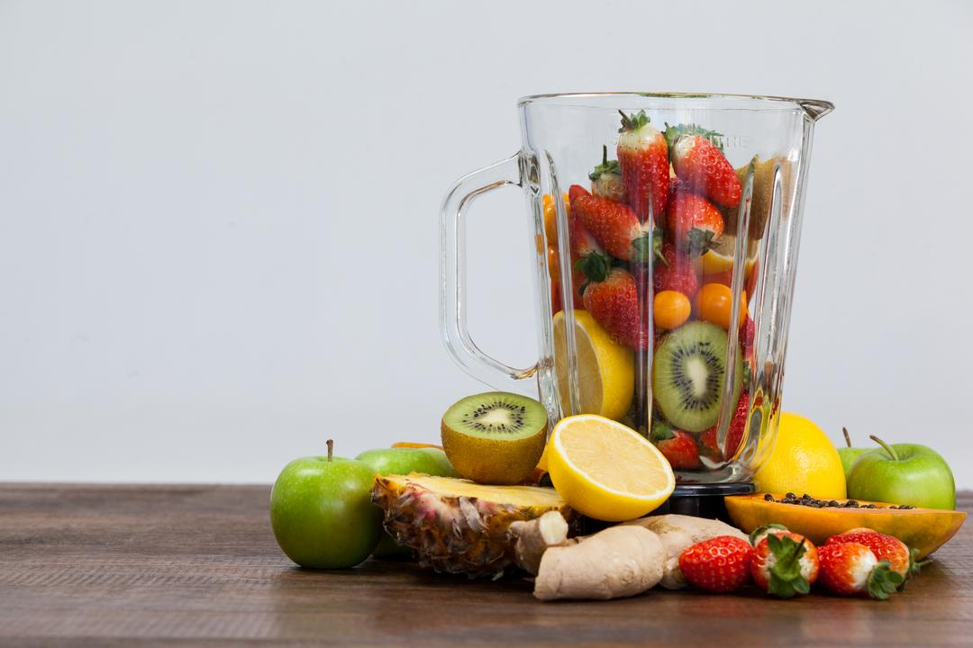 Various fruits and vegetables in blender on table - diet concept Free Stock Images from PikWizard