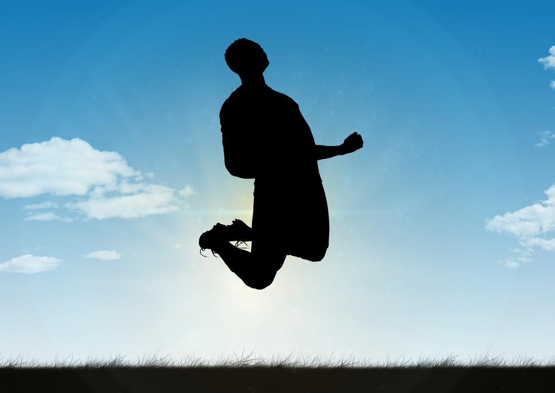 Silhouette of man jumping in mid air with excitement