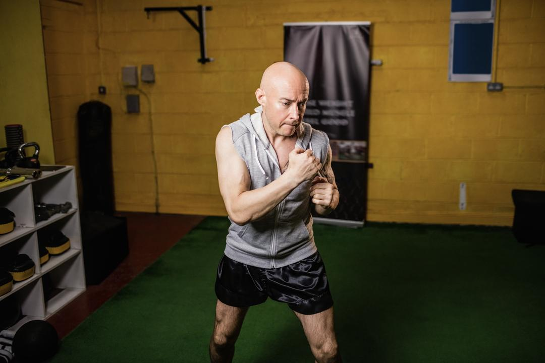 Thai boxer practicing boxing in the fitness studio