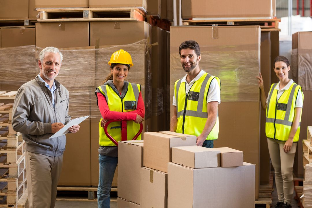 Portrait of warehouse manager and workers preparing a shipment in warehouse Free Stock Images from PikWizard