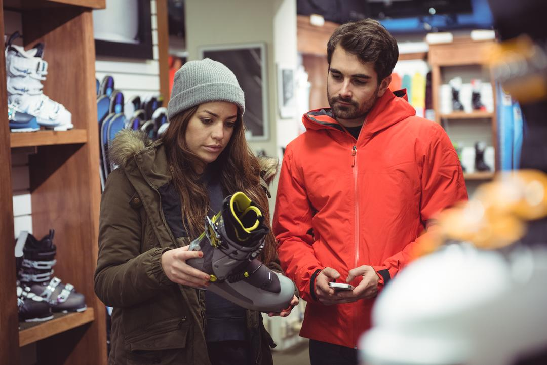 Couple selecting shoe together in a shop