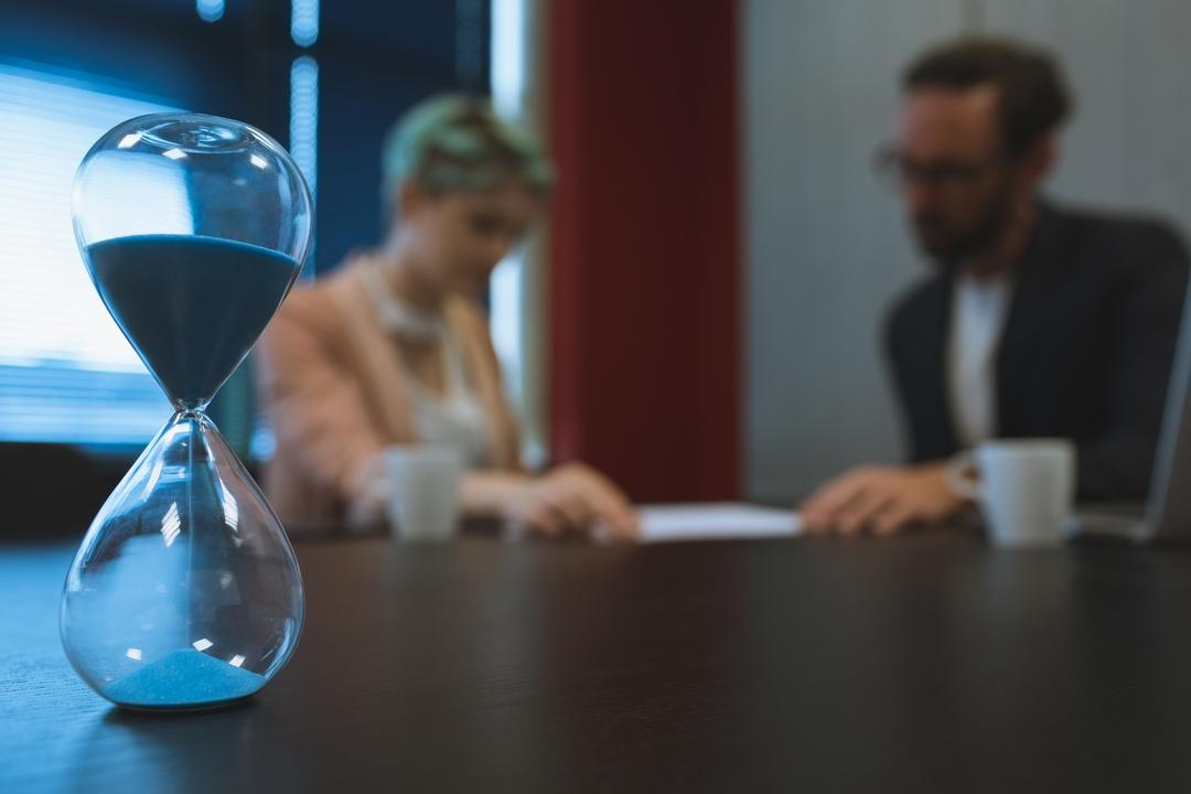 Hourglass on conference table in office
