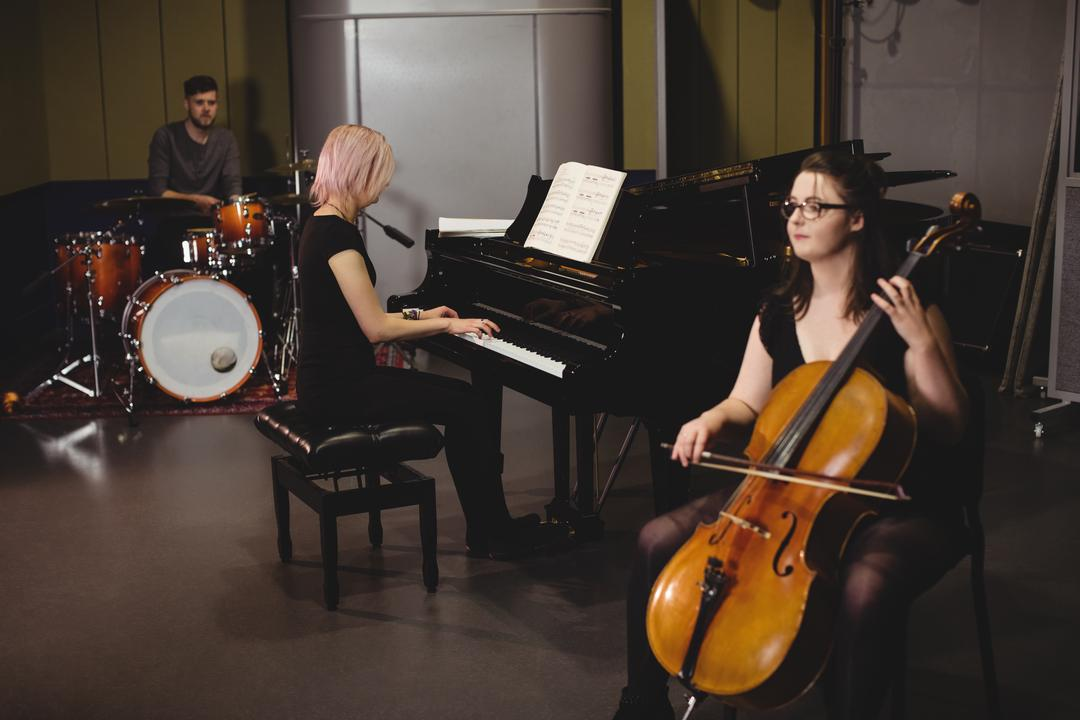 Group of students playing double bass, drum set and piano