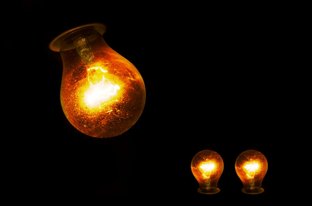 Image of Three Bulbs and a Black Background