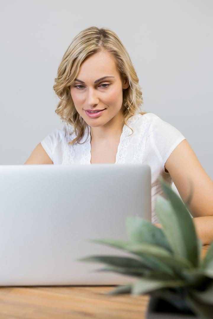 Beautiful woman using laptop at home