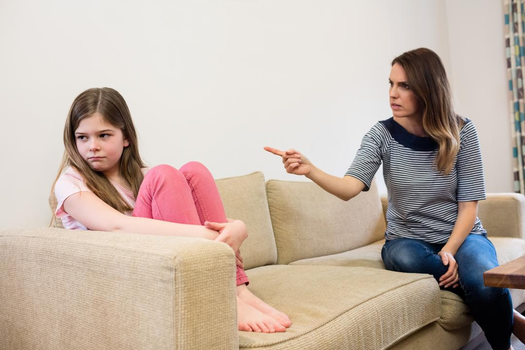 Daughter ignoring her mother after an argument in living room at home Free Stock Images from PikWizard