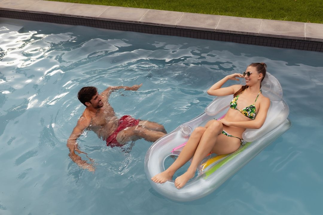 Happy couple having fun together in swimming pool