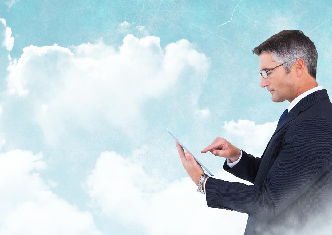 Digital composite of Businessman with tablet with blue cloudy sky