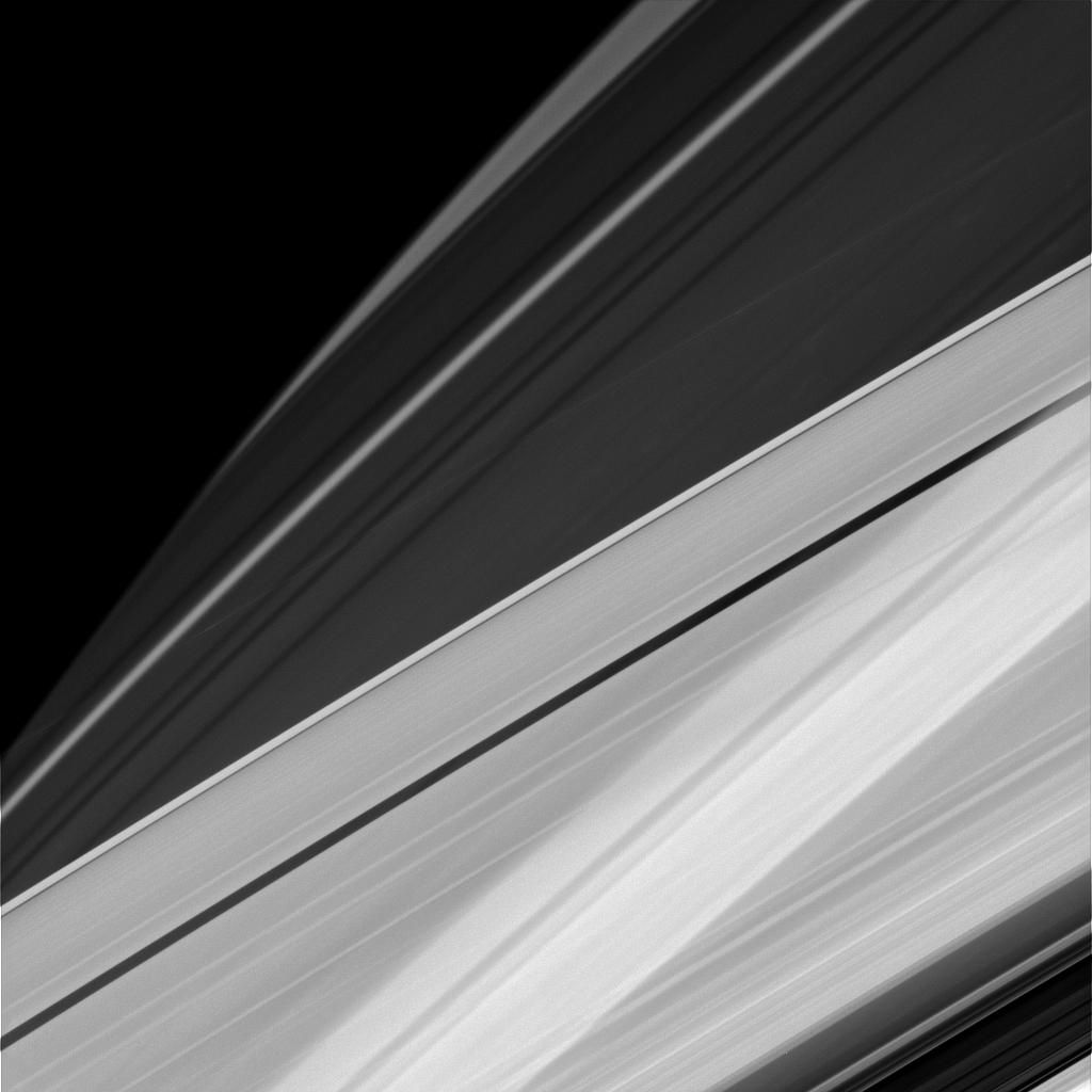 Sometimes at Saturn you can see things almost as if from every angle at once, the way a Cubist might imagine things. For example, in this image, we're seeing Saturn's A ring in the lower part of the image and the limb of Saturn in the upper. In addition, the rings cast their shadows onto the portion of the planet imaged here, creating alternating patterns of light and dark. This pattern is visible even through the A ring, which, unlike the core of the nearby B ring, is not completely opaque.  The ring shadows on Saturn often appear to cross the surface at confusing angles in close-ups like this one. The visual combination of Saturn's oblateness, the varying opacity of its rings and the shadows cast by those rings, sometimes creates elaborate and complicated patterns from Cassini's perspective.  This view looks toward the sunlit side of the rings from about 19 degrees above the ringplane. The image was taken in visible light with the Cassini spacecraft narrow-angle camera on Dec. 5, 2014.  The view was obtained at a distance of approximately 1.2 million miles (2 million kilometers) from Saturn. Image scale is 7 miles (11 kilometers) per pixel.  http://photojournal.jpl.nasa.gov/catalog/PIA18303