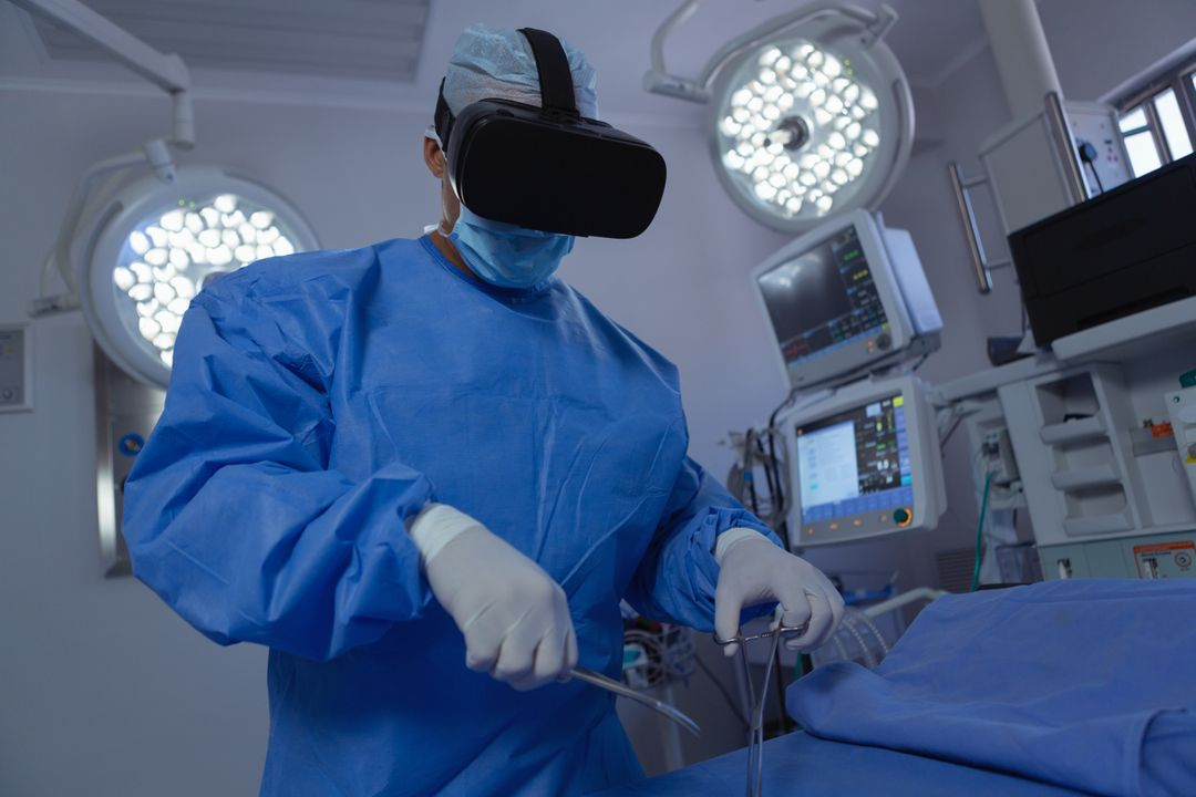Front view of male surgeon using virtual reality headset while practicing surgery in operation room at hospital