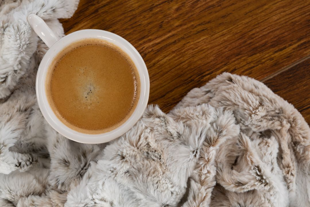 Close-up of blanket and coffee on wooden background Free Stock Images from PikWizard