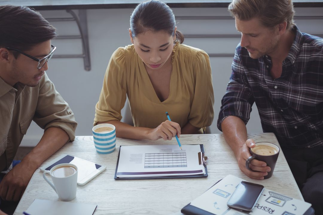 Image of Three People Sitting at a Table and Planning