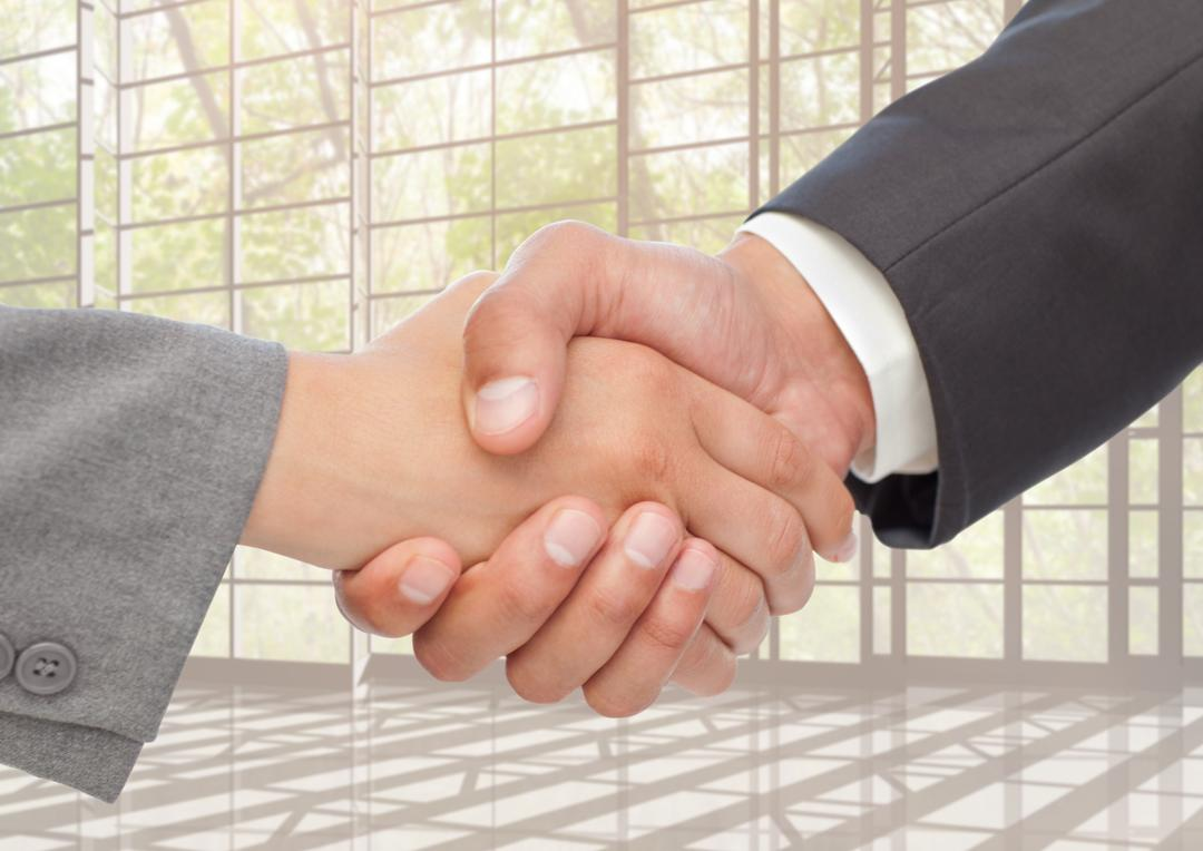 Digital composition of businessman and woman shaking hands