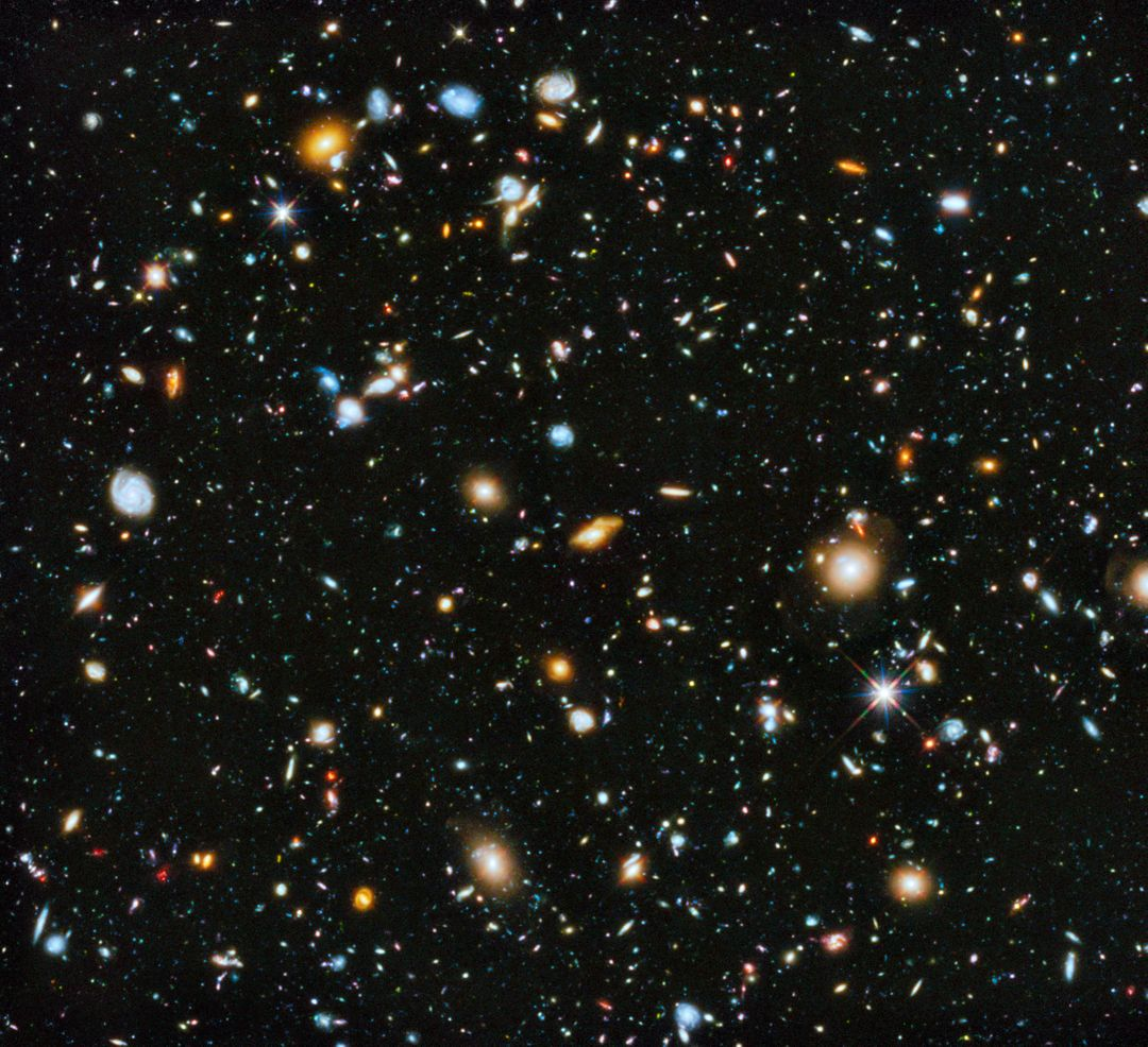 "Astronomers using NASA's Hubble Space Telescope have assembled a comprehensive picture of the evolving universe – among the most colorful deep space images ever captured by the 24-year-old telescope.  Researchers say the image, in new study called the Ultraviolet Coverage of the Hubble Ultra Deep Field, provides the missing link in star formation. The Hubble Ultra Deep Field 2014 image is a composite of separate exposures taken in 2003 to 2012 with Hubble's Advanced Camera for Surveys and Wide Field Camera 3.   Credit: NASA/ESA  Read more: <a href=""http://1.usa.gov/1neD0se"" rel=""nofollow"">1.usa.gov/1neD0se</a>  <b><a href=""http://www.nasa.gov/audience/formedia/features/MP_Photo_Guidelines.html"" rel=""nofollow"">NASA image use policy.</a></b>   <b><a href=""http://www.nasa.gov/centers/goddard/home/index.html"" rel=""nofollow"">NASA Goddard Space Flight Center</a></b> enables NASA's mission through four scientific endeavors: Earth Science, Heliophysics, Solar System Exploration, and Astrophysics. Goddard plays a leading role in NASA's accomplishments by contributing compelling scientific knowledge to advance the Agency's mission.   <b>Follow us on <a href=""http://twitter.com/NASAGoddardPix"" rel=""nofollow"">Twitter</a></b>   <b>Like us on <a href=""http://www.facebook.com/pages/Greenbelt-MD/NASA-Goddard/395013845897?ref=tsd"" rel=""nofollow"">Facebook</a></b>   <b>Find us on <a href=""http://instagram.com/nasagoddard?vm=grid"" rel=""nofollow"">Instagram</a></b>"
