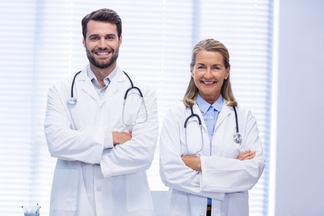 Portrait of doctors standing with arms crossed in clinic Free Stock Images from PikWizard