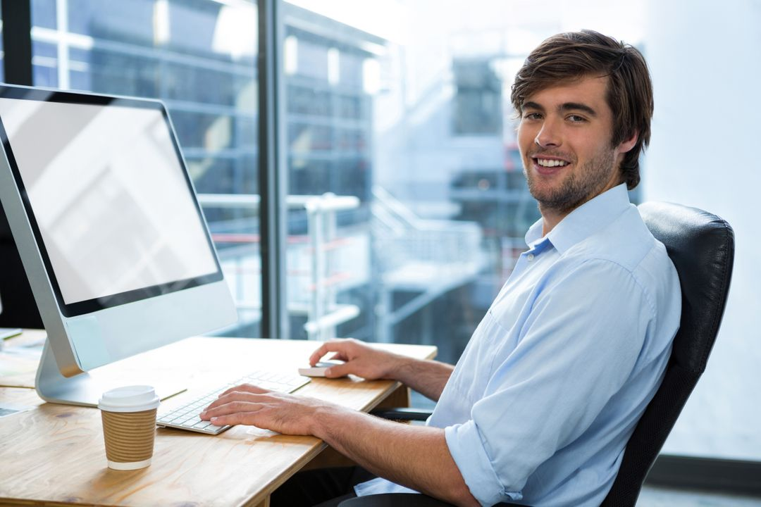 Portrait of businessman working at desk in office Free Stock Images from PikWizard