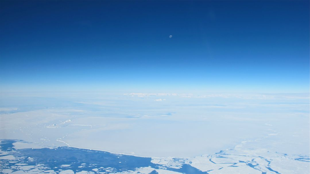 "The moon over the Antarctic Peninsula seen from the IceBridge DC-8 on Oct. 25, 2012. Credit: NASA / James Yungel  NASA's Operation IceBridge is an airborne science mission to study Earth's polar ice. For more information about IceBridge, visit: <a href=""http://www.nasa.gov/icebridge"" rel=""nofollow"">www.nasa.gov/icebridge</a>  <b><a href=""http://www.nasa.gov/audience/formedia/features/MP_Photo_Guidelines.html"" rel=""nofollow"">NASA image use policy.</a></b>  <b><a href=""http://www.nasa.gov/centers/goddard/home/index.html"" rel=""nofollow"">NASA Goddard Space Flight Center</a></b> enables NASA's mission through four scientific endeavors: Earth Science, Heliophysics, Solar System Exploration, and Astrophysics. Goddard plays a leading role in NASA's accomplishments by contributing compelling scientific knowledge to advance the Agency's mission.  <b>Follow us on <a href=""http://twitter.com/NASA_GoddardPix"" rel=""nofollow"">Twitter</a></b>  <b>Like us on <a href=""http://www.facebook.com/pages/Greenbelt-MD/NASA-Goddard/395013845897?ref=tsd"" rel=""nofollow"">Facebook</a></b>  <b>Find us on <a href=""http://instagrid.me/nasagoddard/?vm=grid"" rel=""nofollow"">Instagram</a></b>"