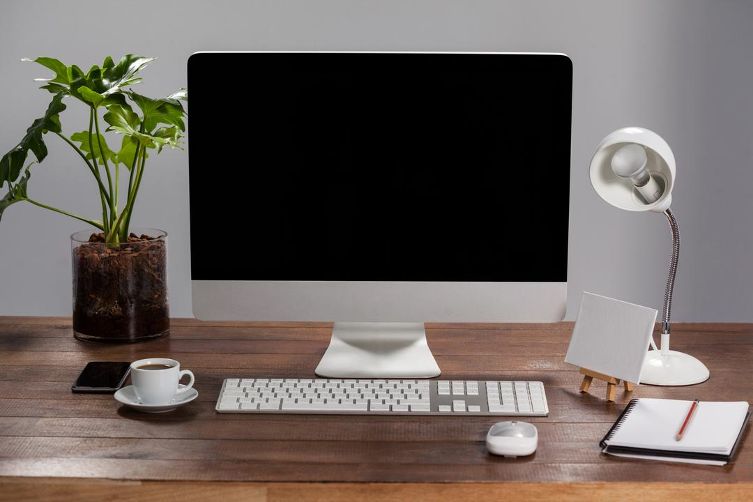 Office desk with pc, personal organizer, mobile phone and belongings in the office