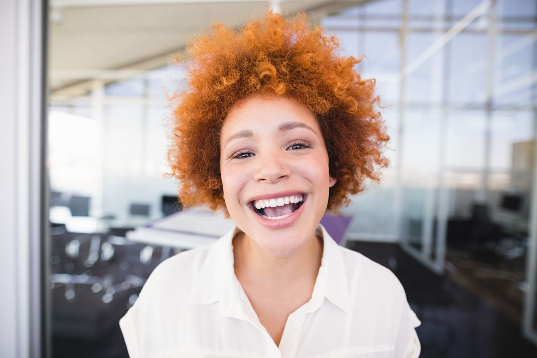 Close up portrait of businesswoman laughing in office Free Stock Images from PikWizard