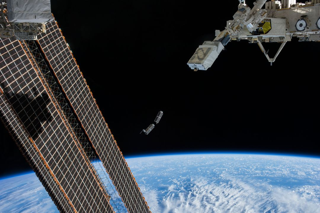 ISS038-E-056389 (25 Feb. 2014) --- A set of NanoRacks CubeSats is photographed by an Expedition 38 crew member after the deployment by the NanoRacks Launcher attached to the end of the Japanese robotic arm. The CubeSats program contains a variety of experiments such as Earth observations and advanced electronics testing. International Space Station solar array panels are at left. Earth's horizon and the blackness of space provide the backdrop for the scene. Free Stock Images from PikWizard