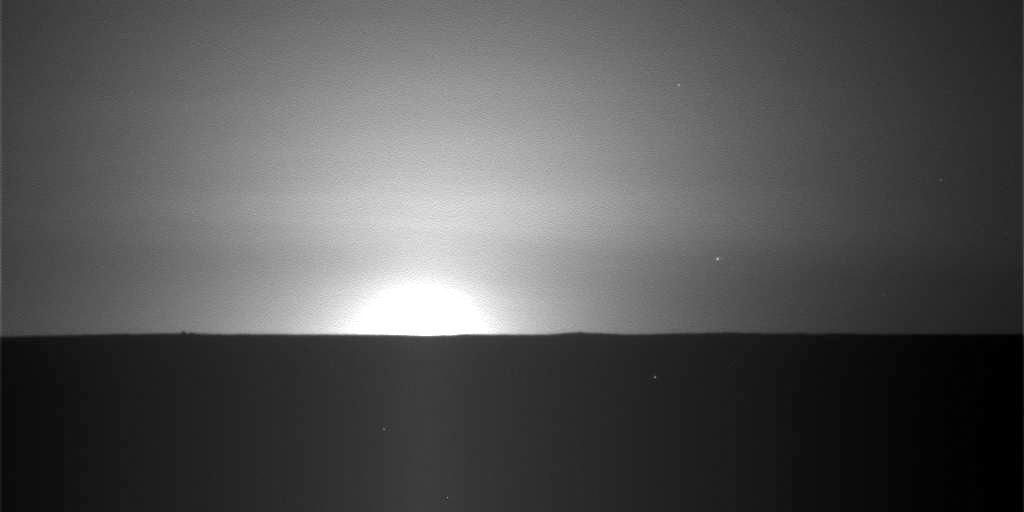 This frame from a sequence of nine images taken by the Surface Stereo Imager on NASA Phoenix Mars Lander shows the sun rising on the morning of the lander 101st Martian day after landing.