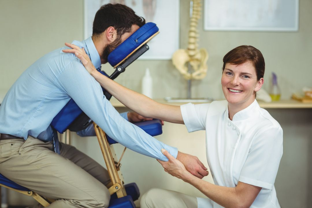 Portrait of physiotherapist giving arm massage to a patient in clinic Free Stock Images from PikWizard