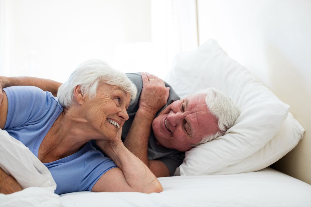 Senior couple relaxing in the bedroom at home Free Stock Images from PikWizard