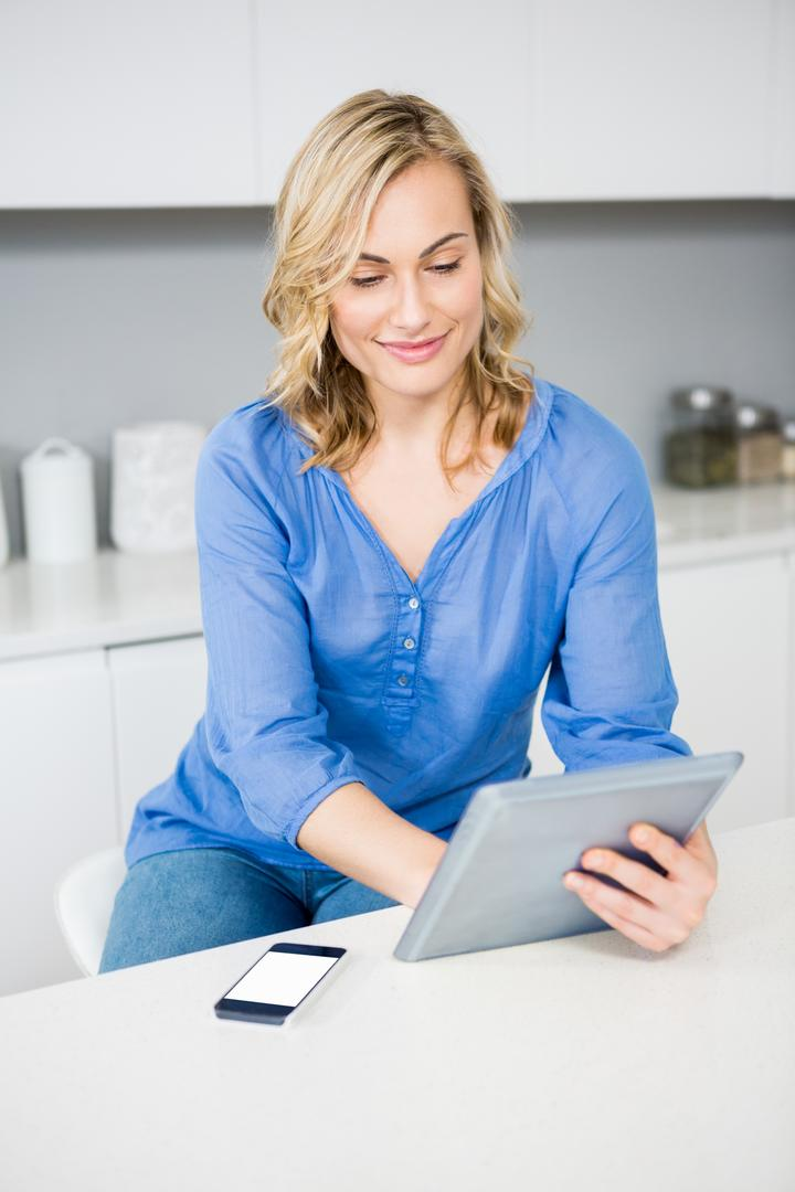 Beautiful woman using digital tablet at home Free Stock Images from PikWizard