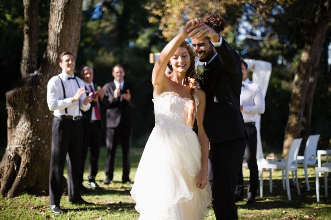 Affectionate couple dancing in park during wedding Free Stock Images from PikWizard