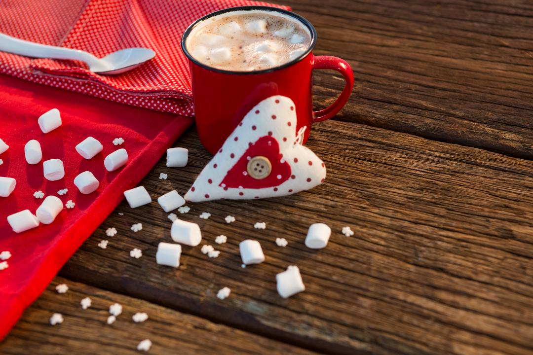 Coffee with sugar cube, napkin and heart on wooden plank during christmas time Free Stock Images from PikWizard