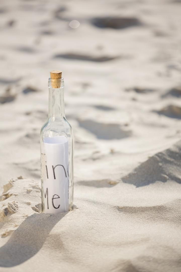 Message in a bottle on the beach Free Stock Images from PikWizard
