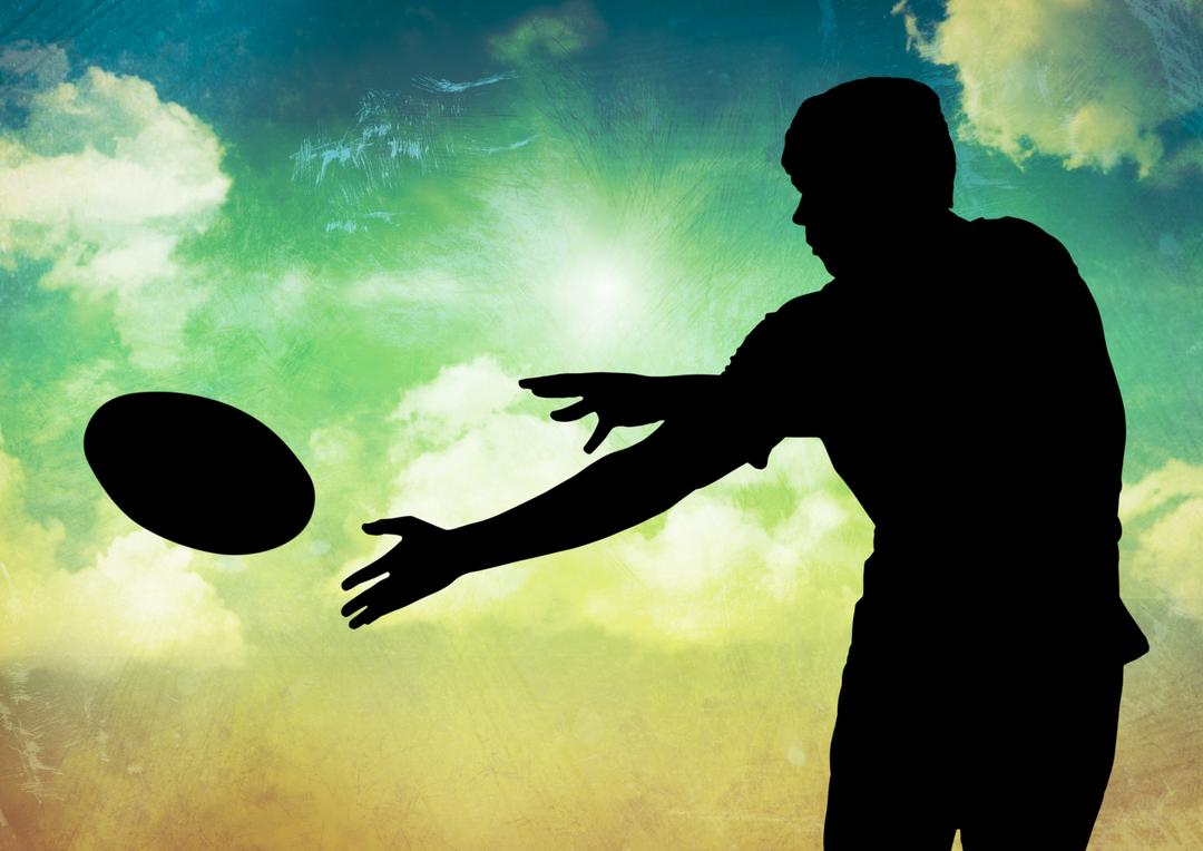 Digital composition of silhouette of player catching a rugby ball against sky in background