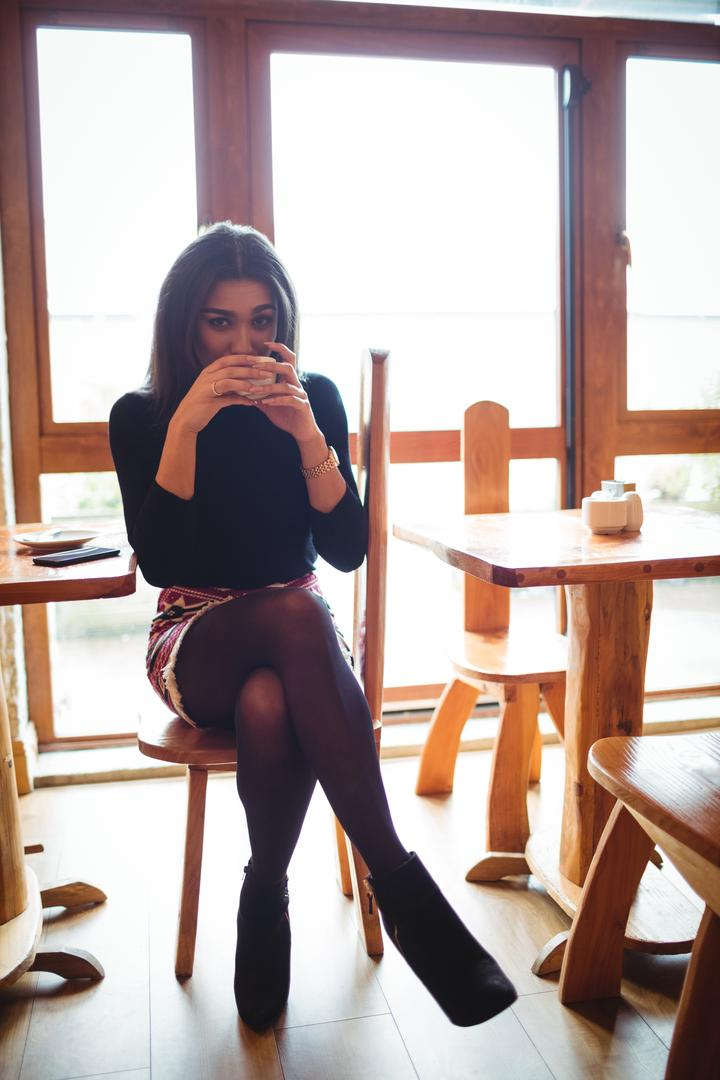 Portrait of beautiful woman having a cup of coffee in cafe