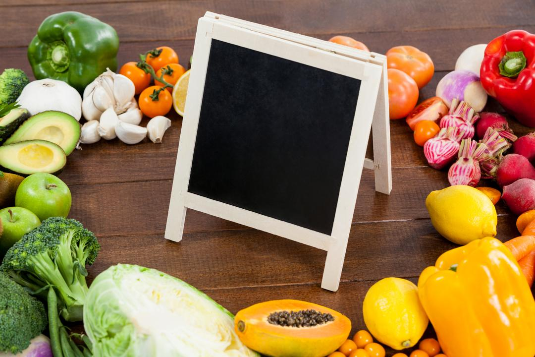 Chalkboard surrounded with fresh vegetables