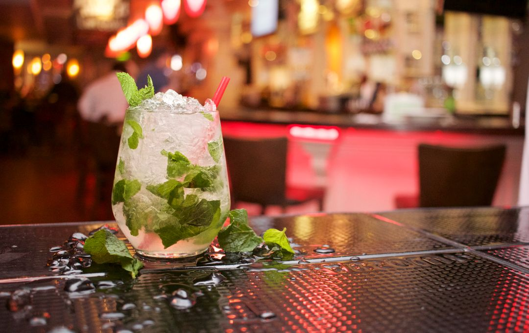 Drink sitting on bar with colourful background