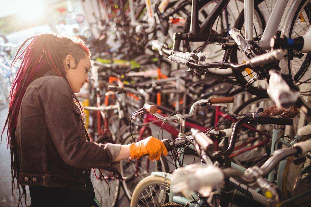 Mechanic examining bicycles in workshop Free Stock Images from PikWizard