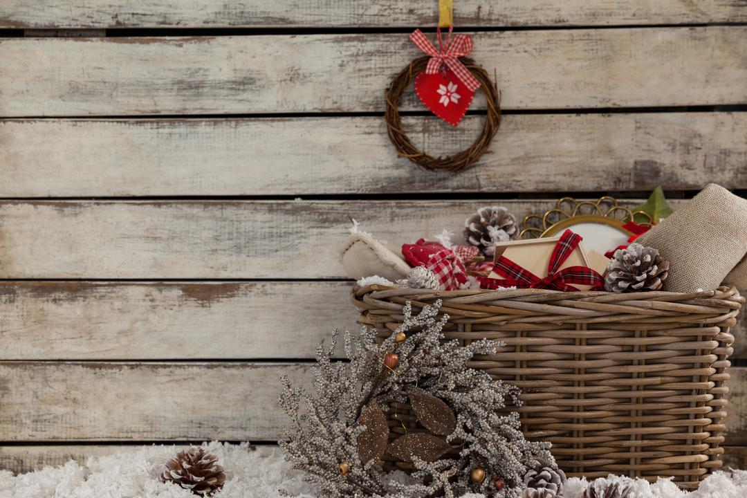 Hanging wreath with basket full of decoration during christmas time
