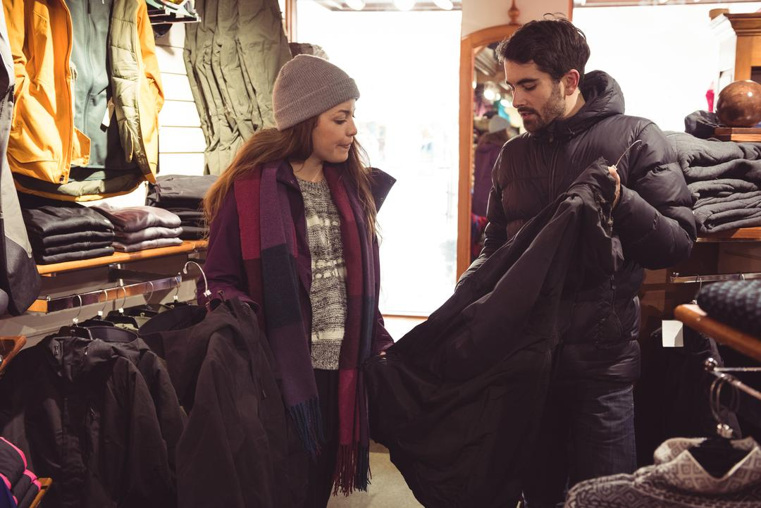 Couple selecting apparel together in a clothes shop Free Stock Images from PikWizard