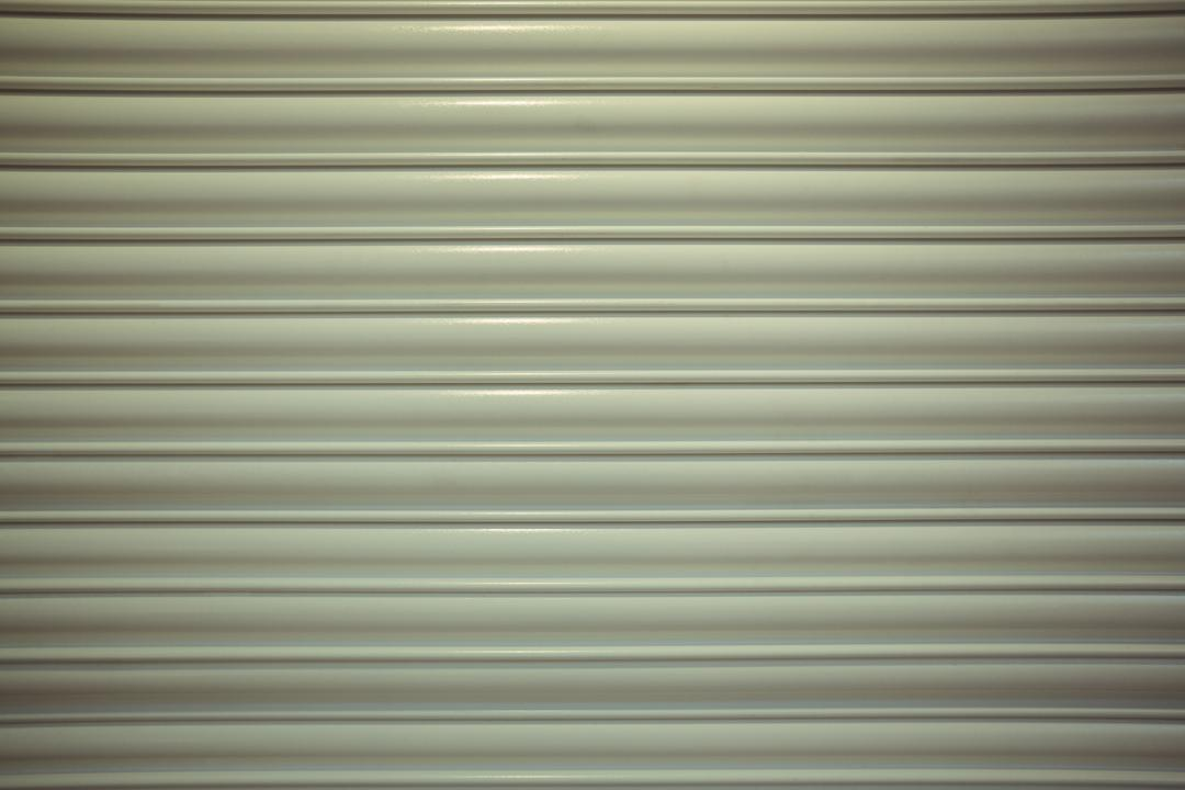 Close-up detail of closed metal security shutter, full frame Free Stock Images from PikWizard