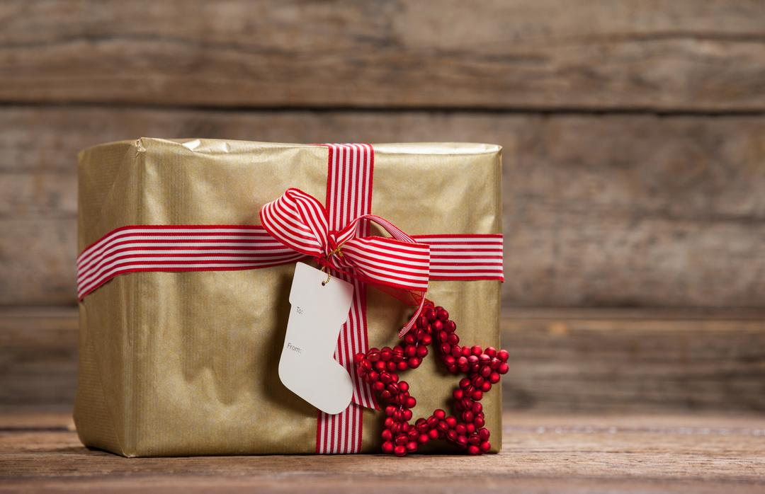 Wrapped gift box on wooden table during christmas time Free Stock Images from PikWizard
