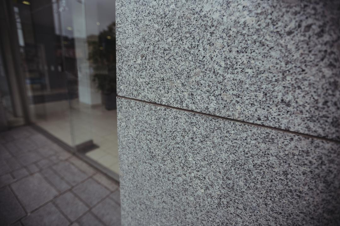 Close-up of modern granite wall in commercial building, background