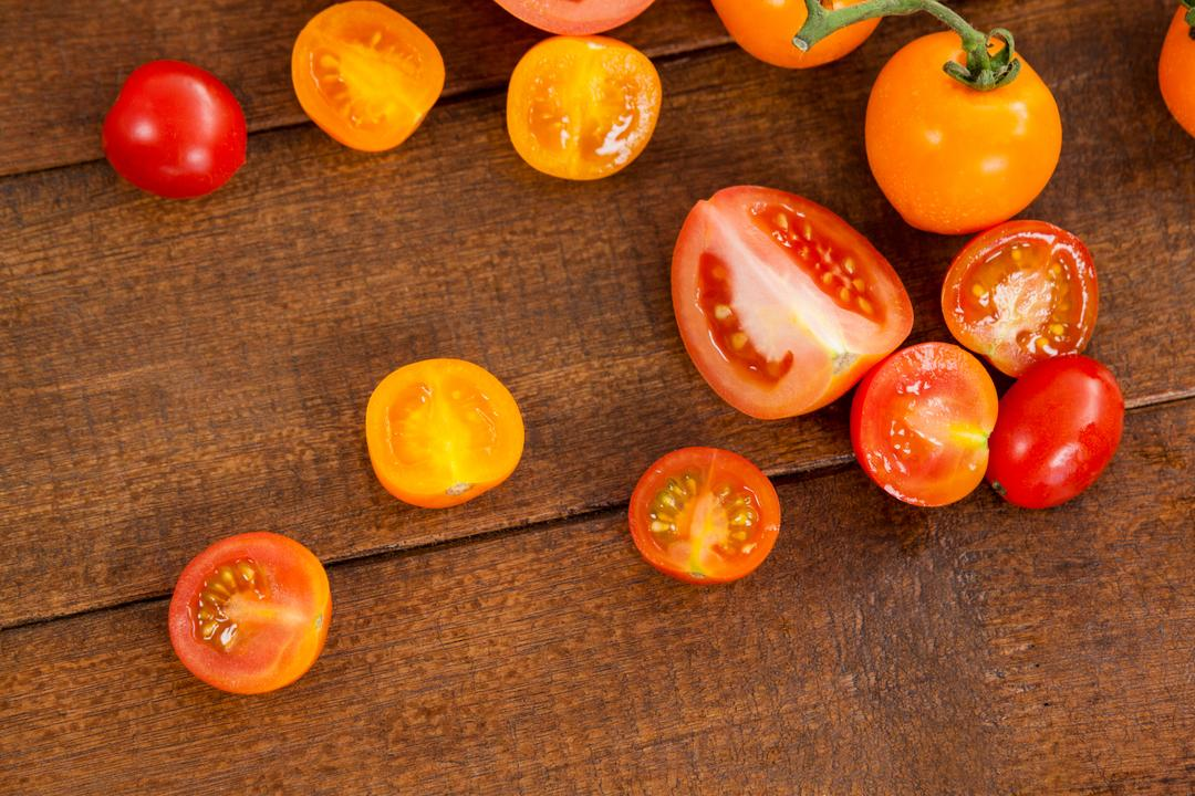 Close-up of various types of tomatoes on wooden table